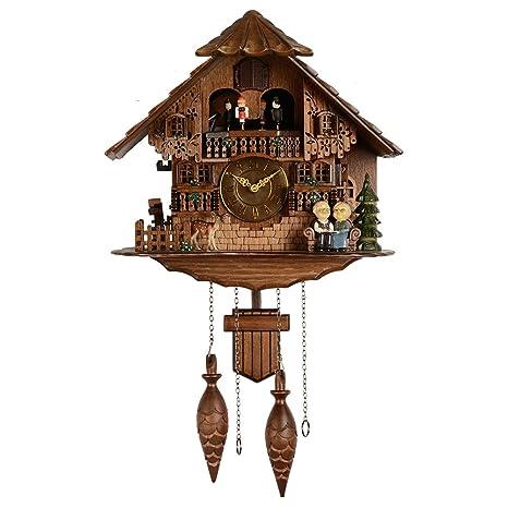 Hense grande marrón hecho a mano madera cuco reloj de pared con idílico ambiente bailando con