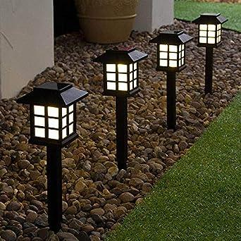 Sureh - 4 luces LED solares de camino para exteriores, impermeables, funciona con energía solar, para jardín, luz cálida, farol solar, estaca para jardín de césped, 28,5 x 9,5 x 8,6 cm: Amazon.es: Iluminación