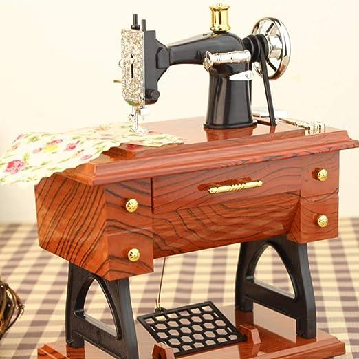 Elegantamazing - Mini máquina de Coser mecánico de Juguete para decoración de Mesa: Amazon.es: Hogar