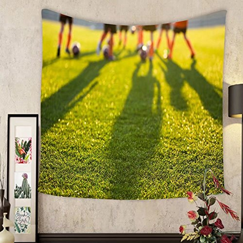 Keshia Dwete Custom tapestry blurred soccer field at school young soccer players training on pitch soccer stadium grass by Keshia Dwete
