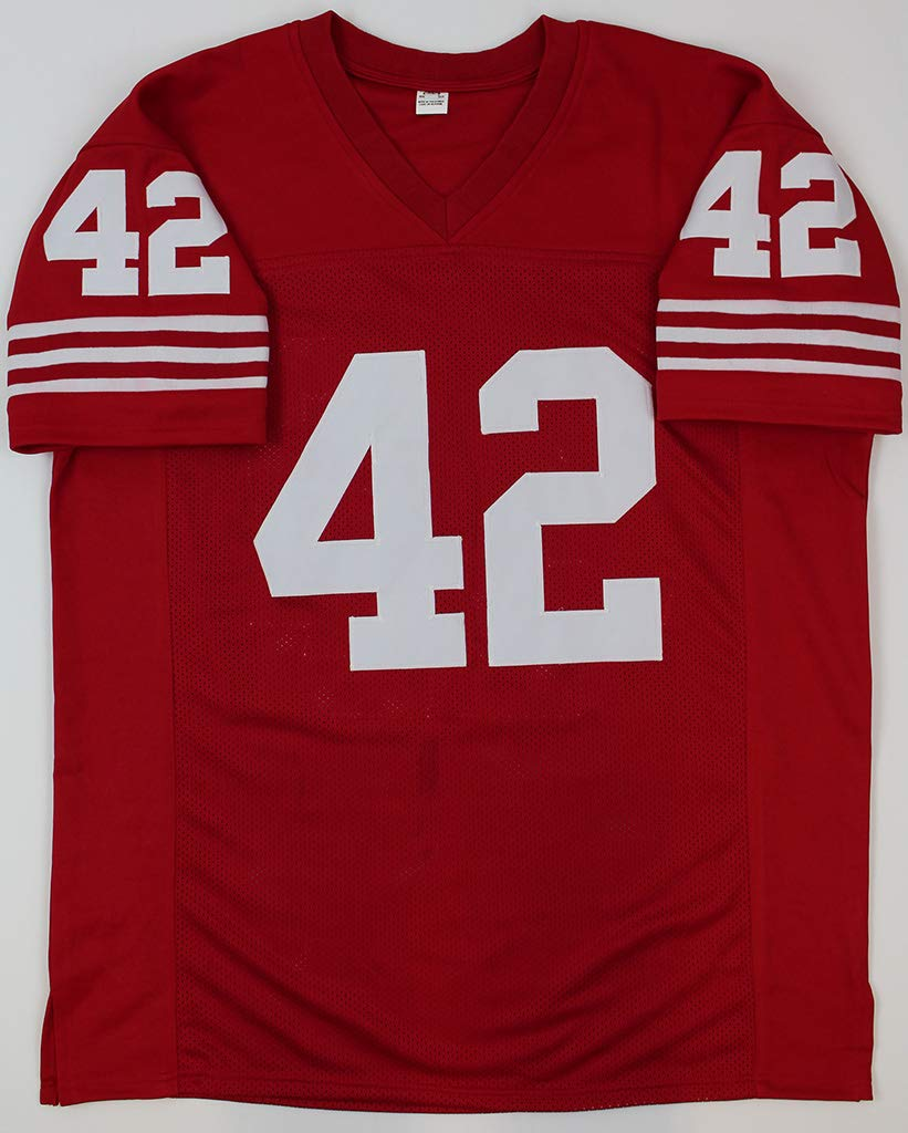 Ronnie Lott Autographed Red San Francisco 49ers Jersey Includes Certificate of Authenticity Hand Signed By Ronnie Lott and Certified Authentic by GTSM