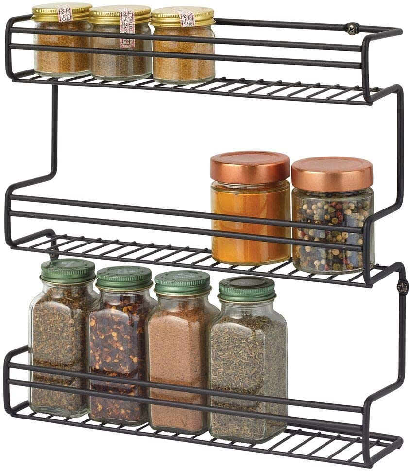mDesign Metal Wall Mount Kitchen Spice Bottle Rack Holder, Food Storage Organizer for Cabinet, Cupboard, Pantry, Shelf - Holds Spices, Jars, Baking Supplies, Cans, 3 Tier - Black