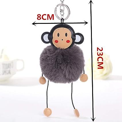 Amazon.com  Cross Key Chain for Men Fluffy Artificial Bunny Fur Ball ... 908eb9e311