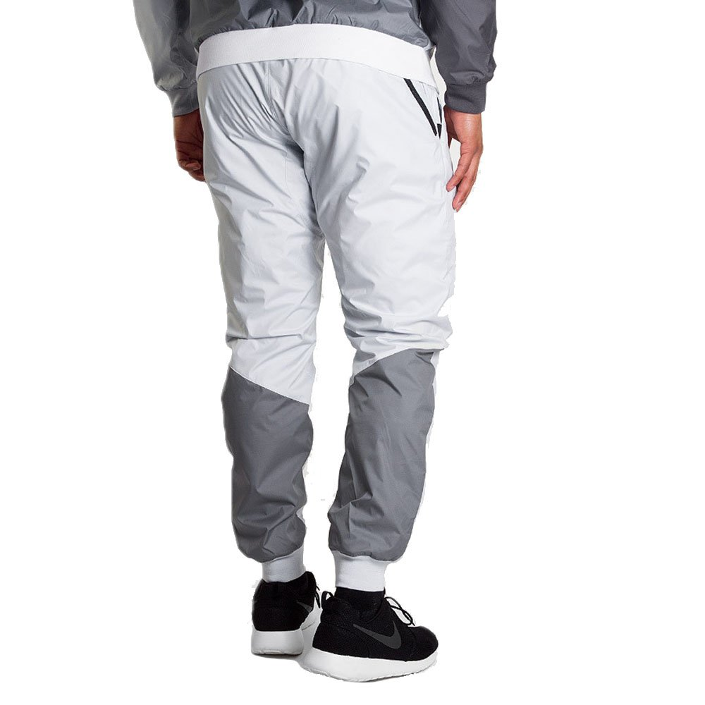 8b0099ade2b06 Amazon.com: Nike Men's Windrunner Cuffed Track Pants Running White Grey  898403 043: Sports & Outdoors