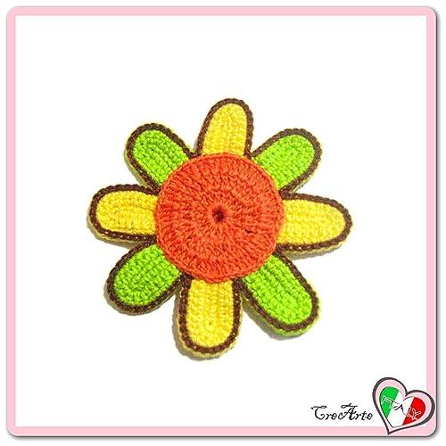 Flor naranja, verde y amarilla para aplicaciones, broche o ...