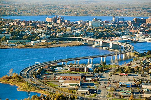 Port Old Maine Portland - Aerial of downtown Portland Maine showing Maine Medical Center Commercial street Old Port Back Bay and the Casco Bay Bridge from South Portland Poster Print by Panoramic Images (36 x 24)