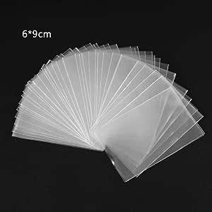 Cuigu Lote de 100 fundas mágicas transparentes para proteger los naipes de los juegos de cartas, como póquer, tarot, Tres Reinos, plástico, transparente, B: Amazon.es: Hogar