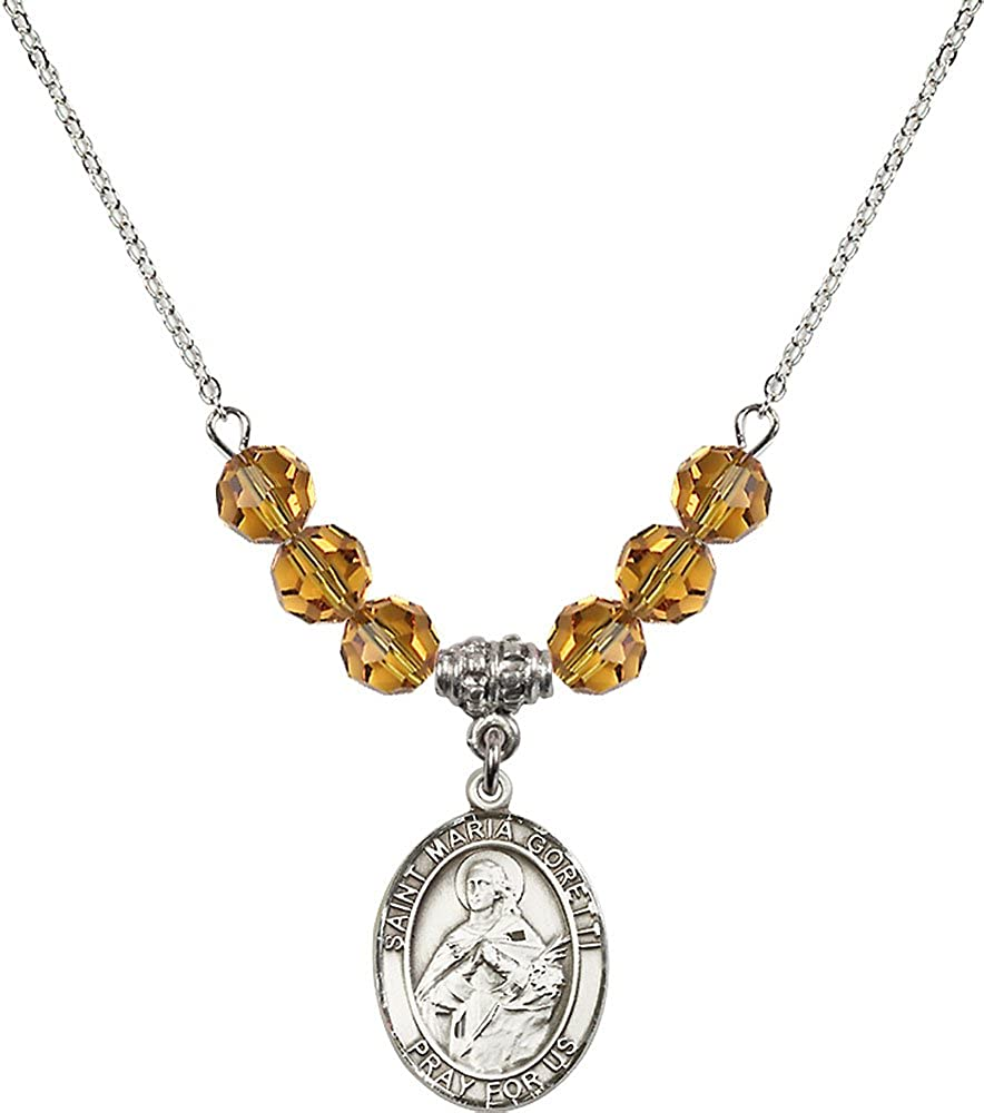 18-Inch Rhodium Plated Necklace with 6mm Topaz Birthstone Beads and Sterling Silver Saint Maria Goretti Charm.