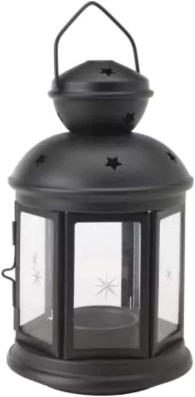 Farol para velas de color negro, apto para uso en interiores y al aire libre, de la marca Ikea Rotera