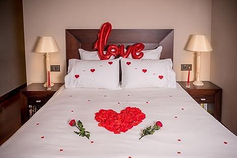 Camere Da Letto Romantiche Con Petali Di Rosa : Pack romantico te quiero petali rosa preservados rose con