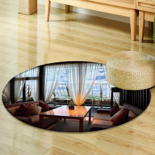 Round Rugs for Bedroom wicker couches and table in empty comfortable restaurant at evening  Circle Rugs for Living Room -Round 31'' by PRUNUSHOME