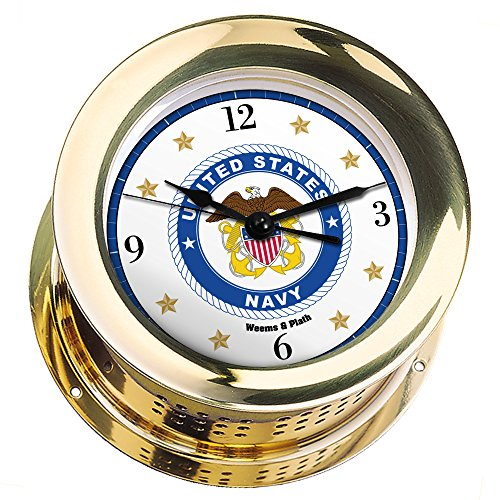 is Brass Quartz Ship's Bell Clock #NV200100 01B (#8 Emblem Printed in Full Color with Black Numbers, Gold Stars, and Navy Blue Border) ()
