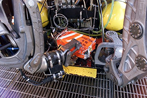 The cockpit voice recorder from the downed Alaska Airlines Flight 261 is held by