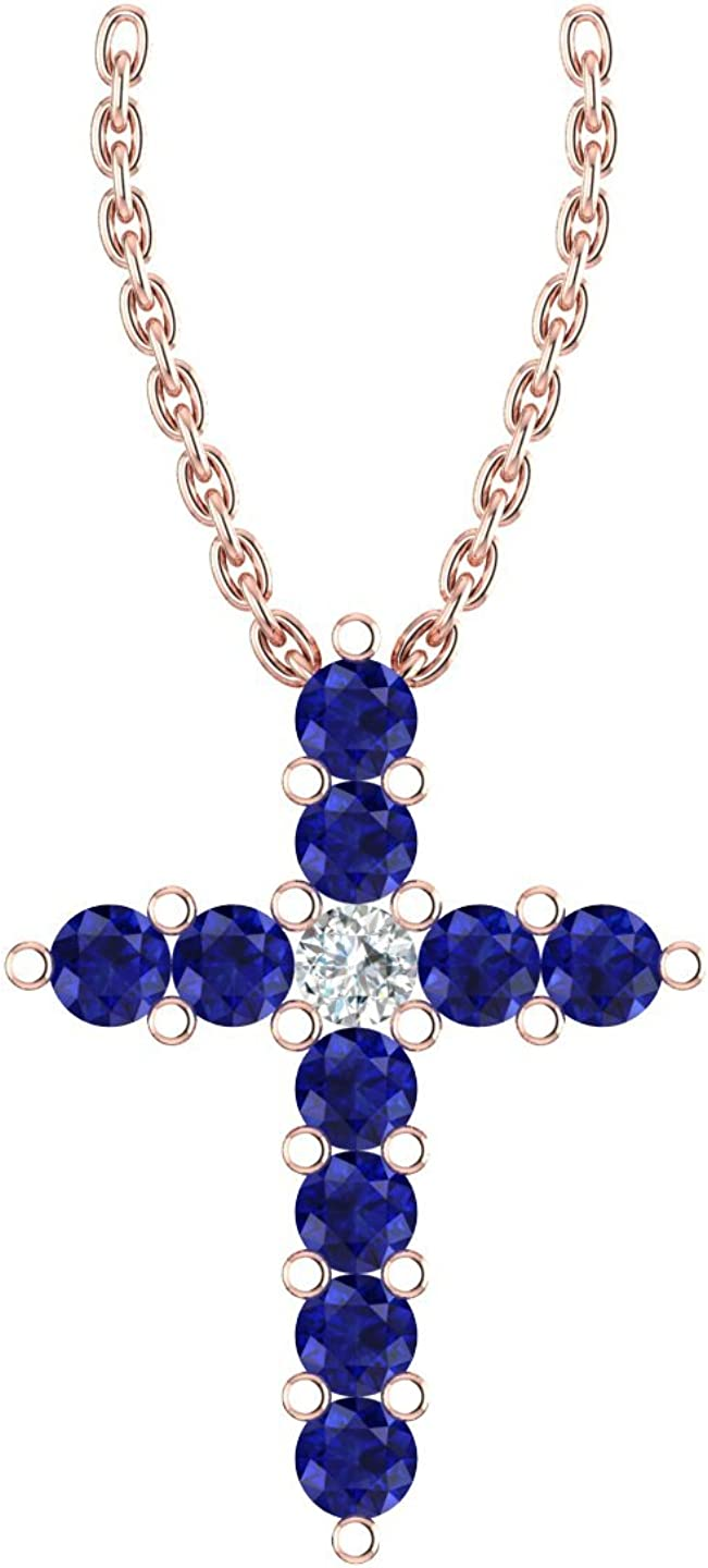 suspended on a 18 Chain 14k Rose Gold delicate cross pendant set with 10 celestial blue sapphires encompassing 1 round white diamond .009ct H-I Color, I1 Clarity .08ct, AA Quality