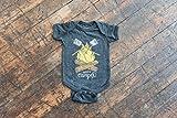 Happy Camper Vintage Black Baby Onesie. Unisex Grey Black Infant cotton poly blend bodysuit with campfire and marshmallows. Celebrates Wilderness.