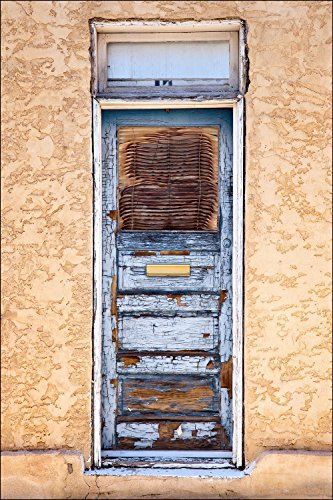 A photograph of a very colorful blue American Southwest door on adobe wall from Southern AZ. This door probably need to new coat of paint, but I like it the way it is with an abundance of character.