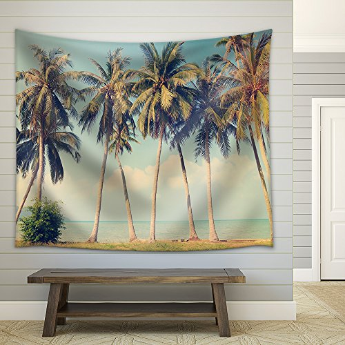 Vintage tropical palm trees on a beach Fabric Wall Tapestry