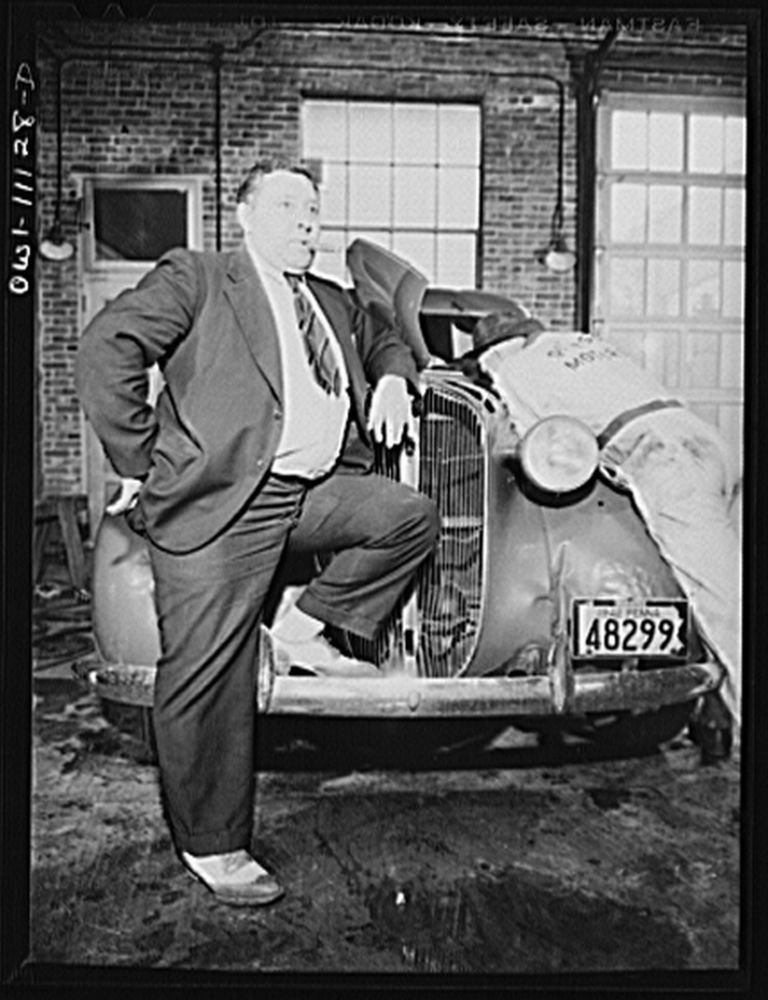 1942 Photo Lititz, Pennsylvania. Irwin R. Steffy having his car gone over in the Pierson Motor Company garage. He uses it to go into Lancaster every day where he is doing a defense job at the Armstron
