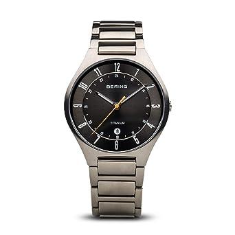 BERING Reloj Analógico para Hombre de Cuarzo con Correa en Titanio 11739-772: Amazon.es: Relojes