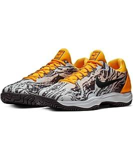 check out ed71b fe6d8 Amazon.com   Nike Men s Zoom Cage 3 Tennis Shoe   Tennis   Racquet Sports