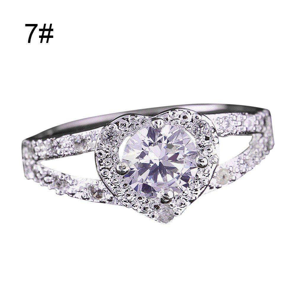 Nihewoo Women's Plated CZ Crystal Engagement Rings Best Promise Rings Anniversary Wedding Bands for Lady Girl (Size 7, Silver)