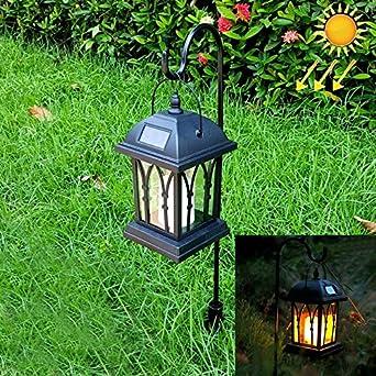 Las luces del paisaje LEH-55142G Lámpara de jardín con luz solar para jardín, vela solar para jardín, poste, y panel solar de silicio amorfo de 0.2W Fiesta de jardin: Amazon.es: Iluminación