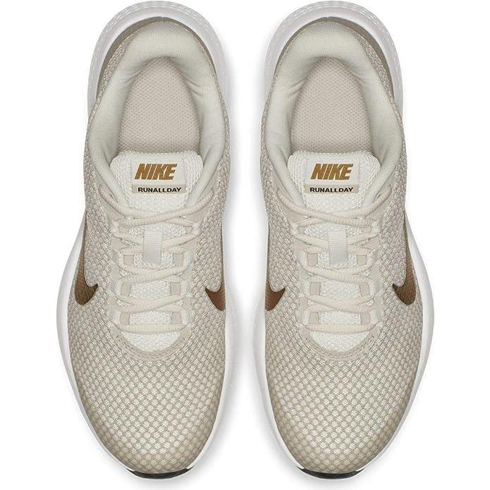 e0574845f1e Nike Women s Runallday Phantm-M Gold Running Shoes (898484-017)  Amazon.in   Shoes   Handbags