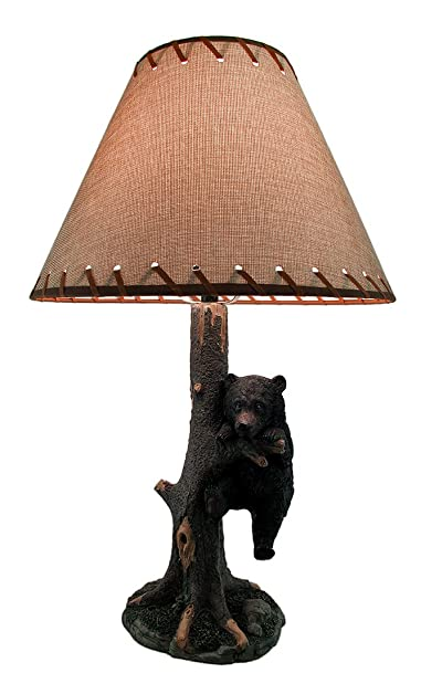 Rustic Black Bear Hanging In A Tree Table Lamp
