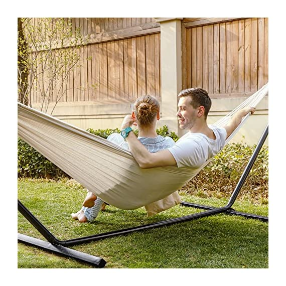 "SONGMICS Cotton Hammock Swing Bed for Patio, Porch, Garden or Backyard Lounging - Heavy-Duty, Lightweight and Portable - Indoor Outdoor - Natural White UGDC15M - UPGRADED FABRIC: 320g/m2 thick fabric, with vibrant colors and is composed of 70% durable cotton and 30% soft polyester; breathable, sweat absorbing and super easy to clean HOLDS UP TO 660LBS: Handcrafted knots at both ends hold up to an impressive 660lbs; 24 strong cotton ropes at each side evenly distributes the load across the surface COZY LIKE A COCOON: With an overall length of 138"" and a large surface sized 99"" x 59"", this comfy hammock is the perfect spot for lounging, napping, reading and happy family times - patio-furniture, patio, hammocks - 61PFkqlbtRL. SS570  -"