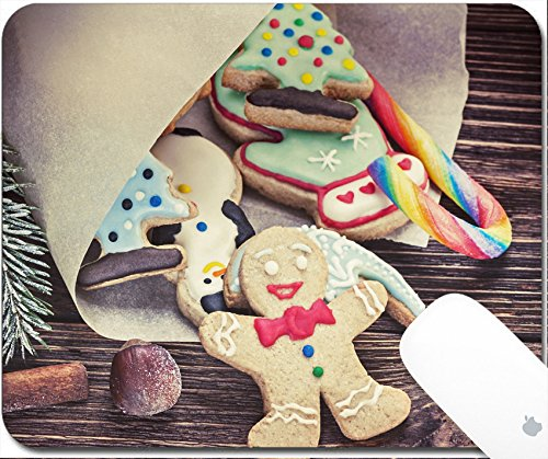 Gingerbread Man Frosting - Luxlady Gaming Mousepad 9.25in X 7.25in IMAGE: 34268434 Smiling gingerbread men nestled in holiday the background of Christmas decorations toning image