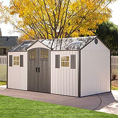 large plastic shed in a garden on the lawn