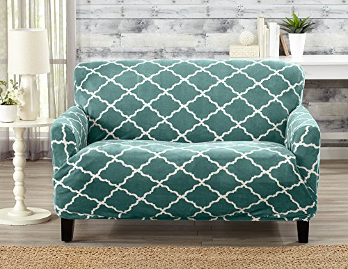 Form-fitting, printed slipcover in dark Teal.