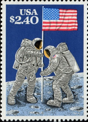 MOON LANDING APOLLO 11 FIRST MAN ON THE ASTRONAUTS PLANTING FLAG
