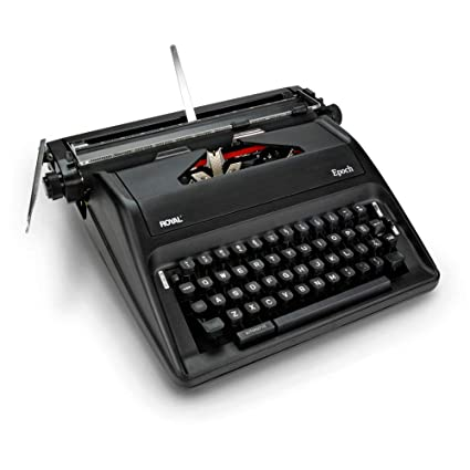 Vintage manual metal typewriter royal quite de lux working good.