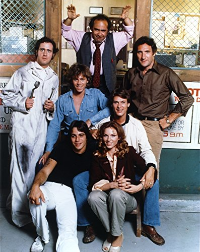 Taxi Cast Lady with Six Men posed Outside of the Store Photo Print (24 x 30) ()
