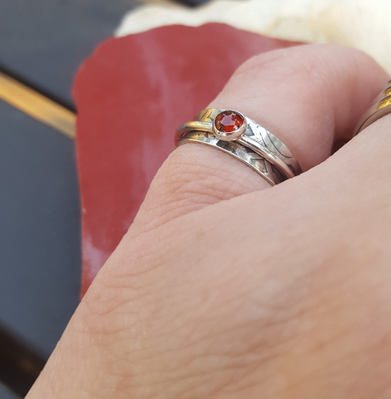 Amazon.com: Slim Spinner ring with Garnet and patterned sterling ...