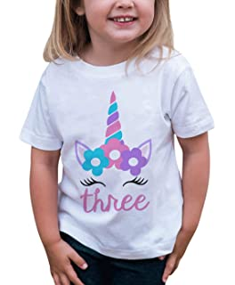 e5132afc3e059 Amazon.com  7 ate 9 Apparel Kids Seventh Birthday Unicorn T-Shirt ...