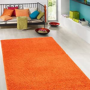 Ottomanson Soft Cozy Color Solid Shag Rug Contemporary Living and Bedroom Soft Shaggy Kids Rugs, 5' x 7', Orange