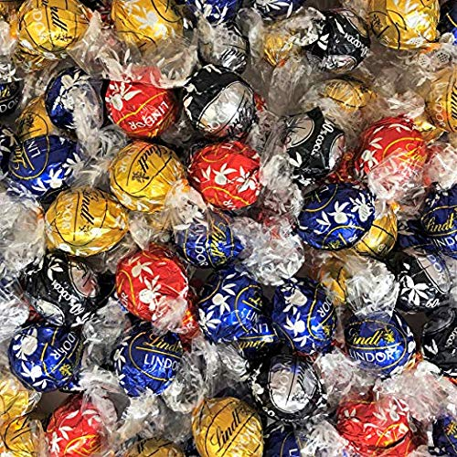 - Lindt Lindor Chocolate Truffles 4 Flavors Assorted Truffle Box 60 Truffles, (Milk Chocolate, White Chocolate, Dark Chocolate, Extra Dark Chocolate)