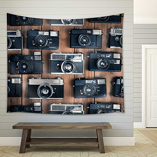 Old camera on the wooden table Fabric Wall Tapestry