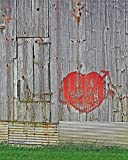 Heart on a Barn. Photograph of a rustic gray barn with weathered siding is decorated with a red, spray paint Valentine's Day Heart. A rustic Valentine's Day art print for the one you love.