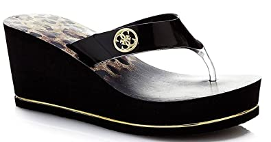 07b21e3c9ccf3 Image Unavailable. Image not available for. Colour   Guess Shadia2 Black  Gold Womens Wedge Flip Flops