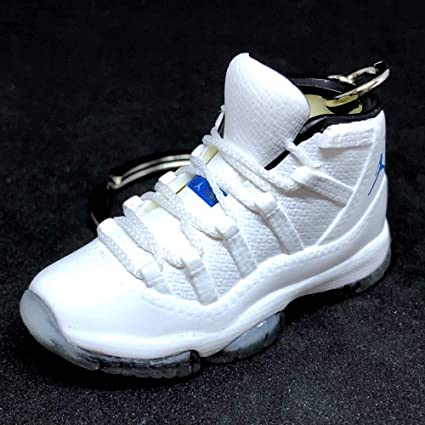 best sneakers e5c4c 11c5a Amazon.com : Air Jordan XI 11 Retro Hi Columbia White Legend ...