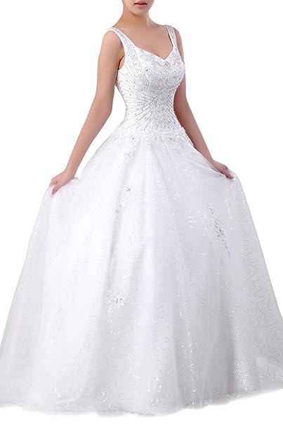 La mano rebordea el tren largo del vestido de boda de las correas sin mangas del