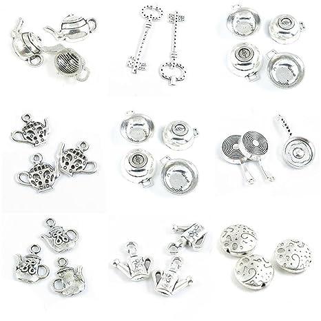 cc219b48409e 28 piezas de charms de tono plateado envejecido para hacer joyas ...