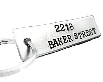 221B BAKER St. Llavero, mano con sello de Sherlock Holmes ...