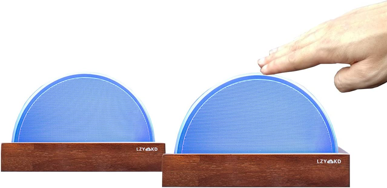 A pair of long distance touch lamps in blue color and brown wooden base.
