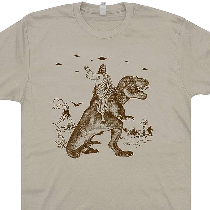 5b3b00d5 S - Jesus Riding a Dinosaur T Shirt Funny UFO Tee Offensive Evolution  Charles Darwin Alien