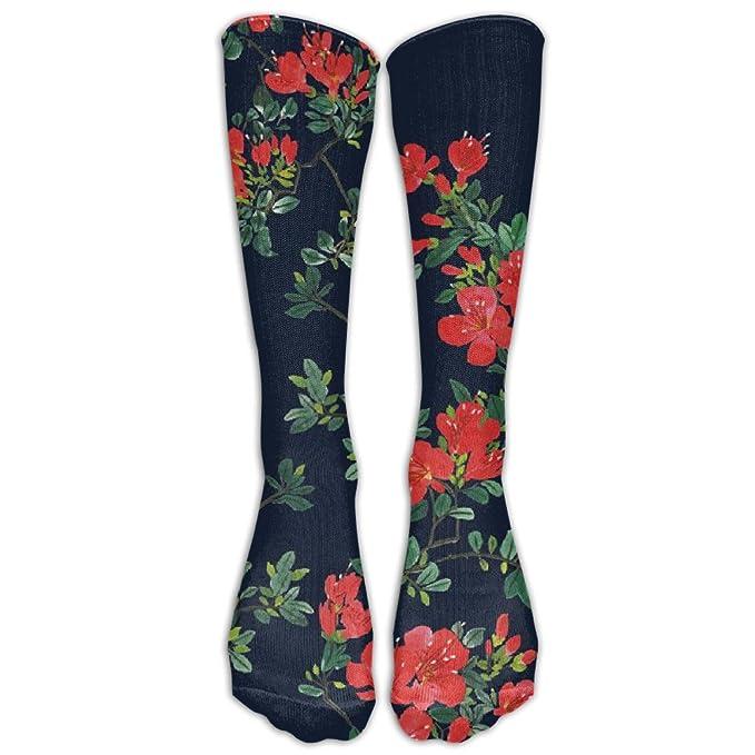cd94681532 Calcetines de algodón y spandex de un largo que llega hasta la rodilla.  Diseño estampado con cayenas exóticas.