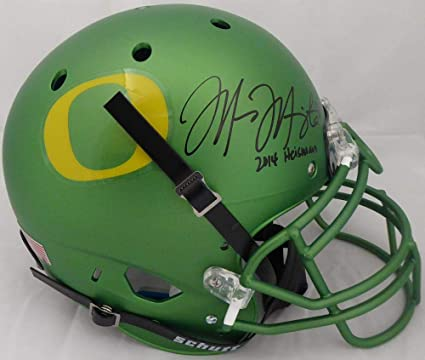 af0d9b93790 Image Unavailable. Image not available for. Color  Marcus Mariota  Autographed Oregon Ducks Authentic Schutt Apple Green Full Size ...